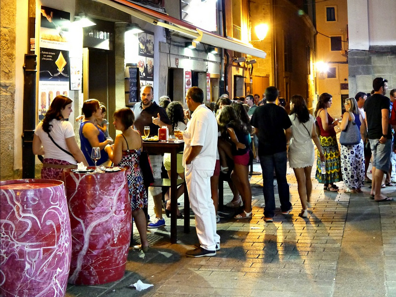 Locals socialising over food in the streets of Logroño in Spain