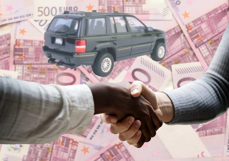 Photo of a car with a background of euro notes and a handshake happening in the foreground