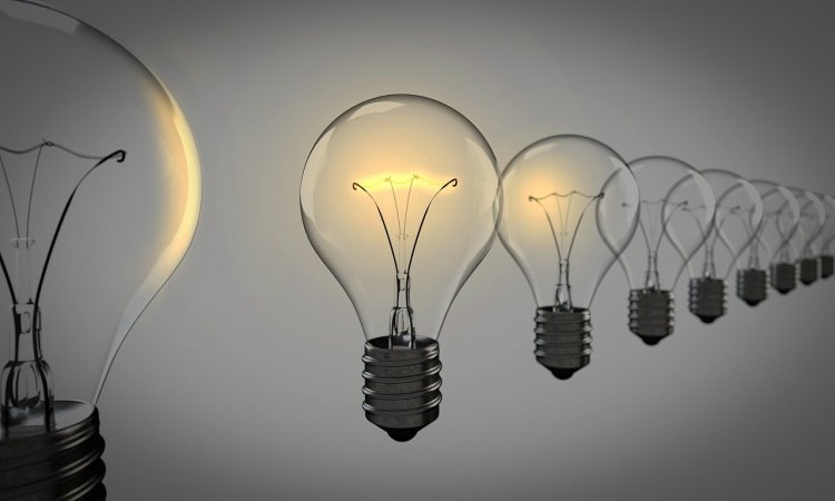 Image showing a row of floating lightbulbs in front of a grey background.