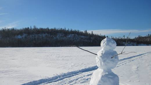 Snowman on Round Lake at the edge of the Boundary Waters