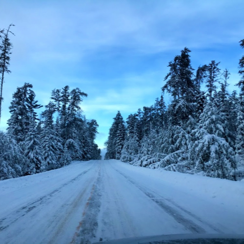 The snow-covered Gunflint Trail Road in northern Minnesota outside of Grand Marais, MN