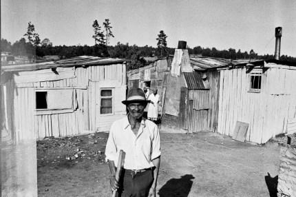 A resident outside his Lawaikamp home.