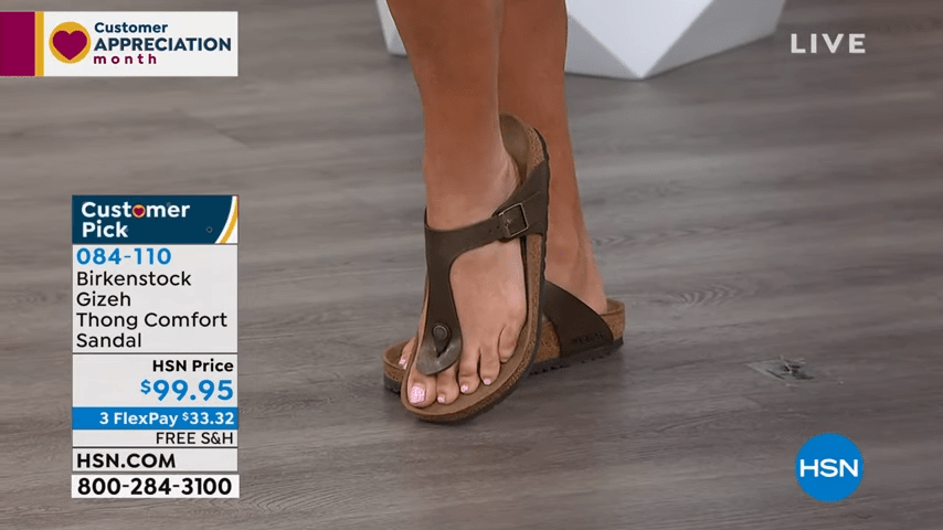 Close-up shot of HSN show host Suzanne Runyan's feet during an on-air presentation.