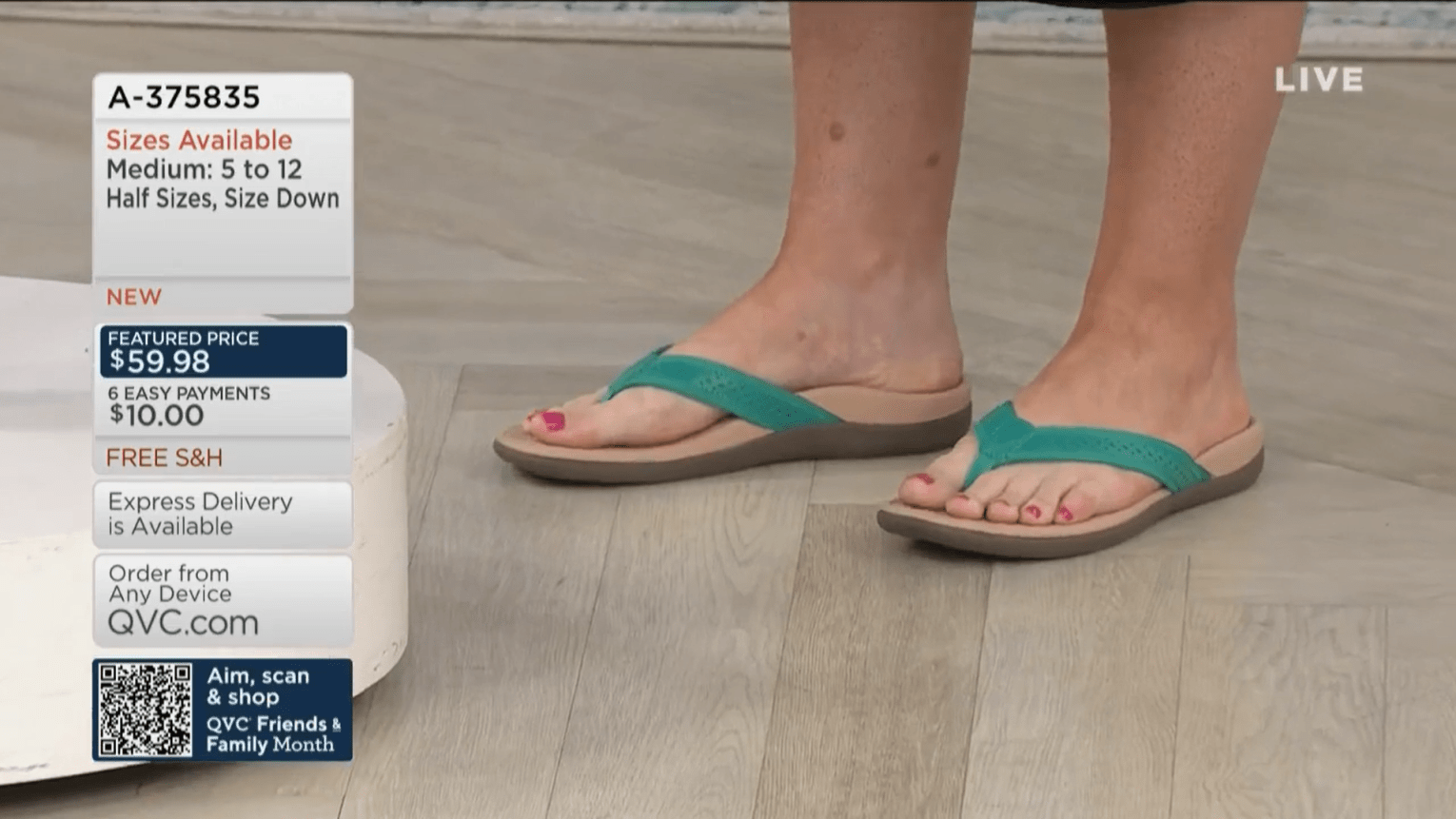 Close-up shot of QVC show host Mary DeAngelis's feet in Vionic thong sandals.