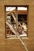 Tornado damage framed by window