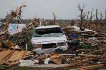 Damaged cars in tornado rubble