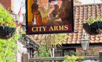 City Arms, Wells. Only caught a bit of the sign. The pub is situated in what used to be the Wells city jail.