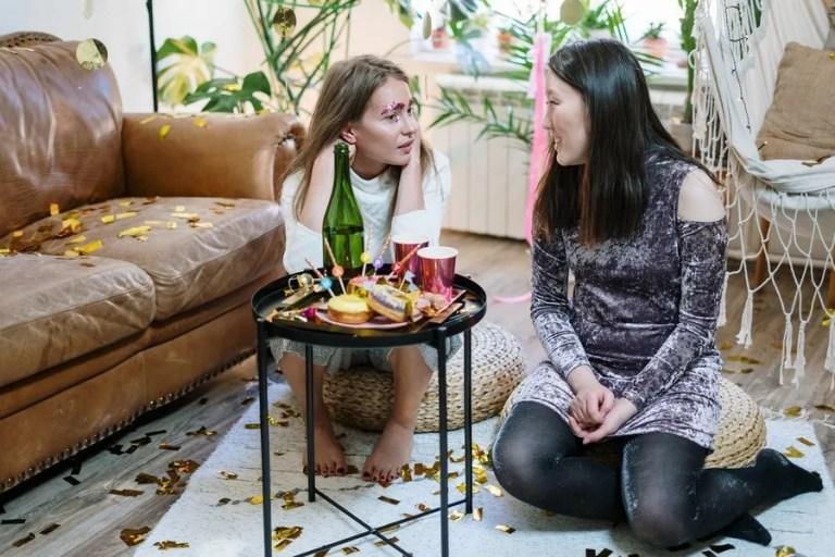 two women on floor telling their stories