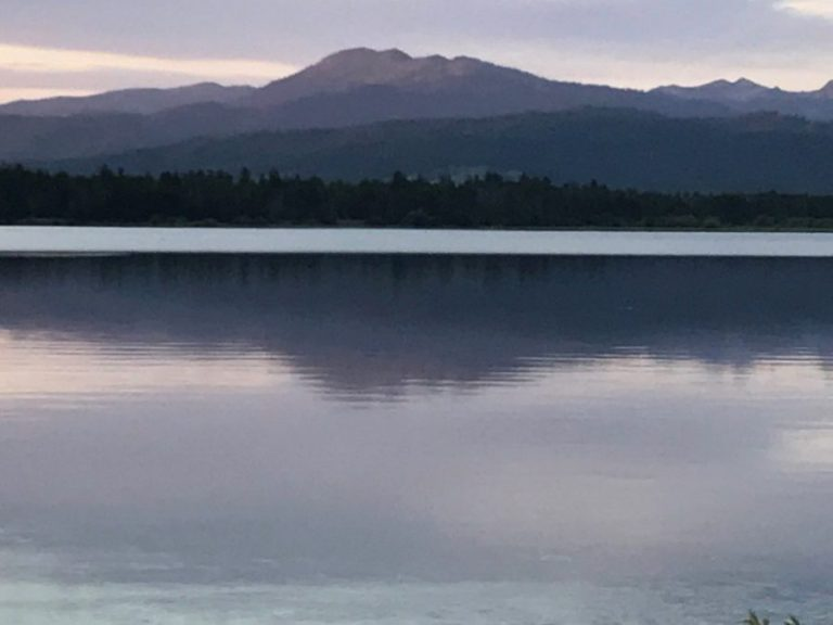 still lake below mountains