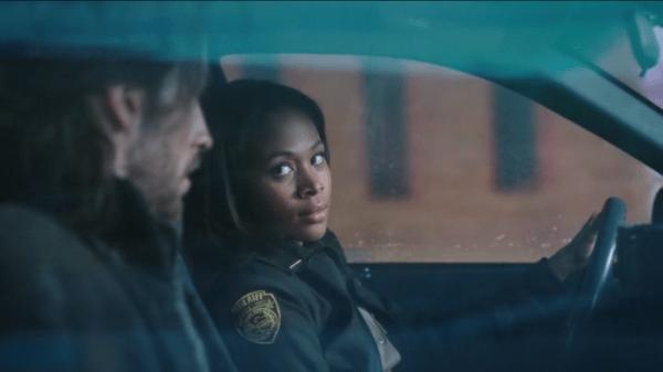 Abbie Mills (Nicole Beharie) escorts Ichabod Crane (Tom Mison) in a squad car on Sleepy Hollow