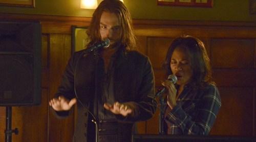 Ichabod Crane (Tom Mison) and Abbie Mills (Nicole Beharie) perform karaoke on Sleepy Hollow.