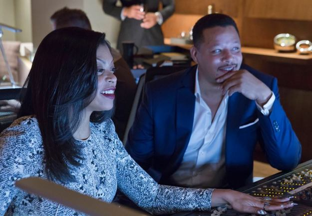 Lucious and Cookie smile a they work together on producing a song at Empire