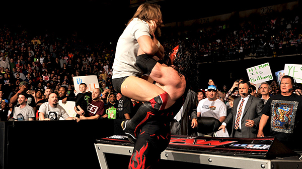 Despite Stephanie McMahon's protests, Kane attacks Bryan. Photo Credit: WWE