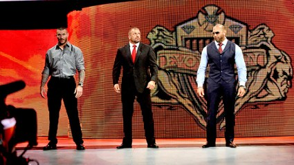 Evolution -- Randy Orton, Triple H and Batista -- make their way to the ring. Photo Credit; WWE