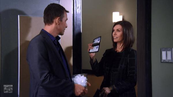 Anna shows Valentin her credentials.