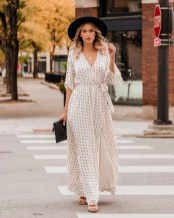 Beautiful polka dot kimono maxi dress showcases a black polka dot print with gold metallic threading on a creamy soft base