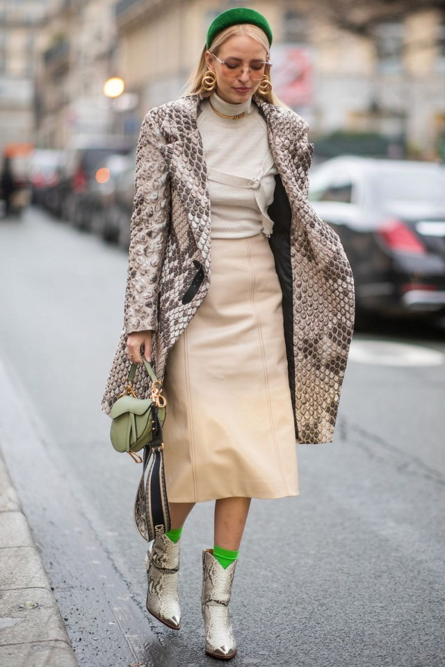Beautiful animal print coat and ankle boots combine with contrasting colored accessories