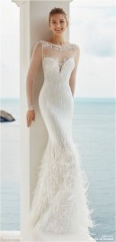 1 dress with feathers at the bottom sourceworldofbridalcom