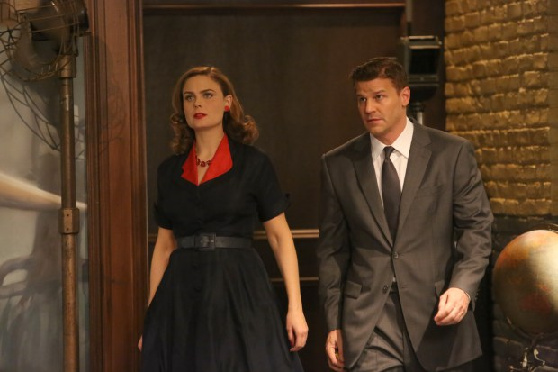 "BONES:  In an episode that reimagines the Jeffersonian and FBI teams in 1950s Hollywood, Brennan plays an LAPD detective, and Booth is a notorious jewel thief who is far more than he seems to be. When Booth is framed for a murder, he and Brennan team up to clear his name and find the killer in the ""The 200th in the 10th"" 200th episode of BONES airing Thursday, Dec. 11 (8:00-9:00 PM ET/PT) on FOX.  Pictured L-R:  Emily Deschanel and David Boreanaz.  ©2014 Fox Broadcasting Co.  Cr:  Patrick McElhenney/FOX"