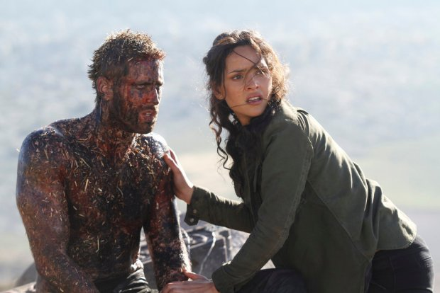 "EMERALD CITY -- ""The Beast Forever"" Episode 101-- Pictured: (l-r) Oliver Jackson Cohen as Lucas, Adria Arjona as Dorothy -- (Photo by: Rico Torres/NBC)"