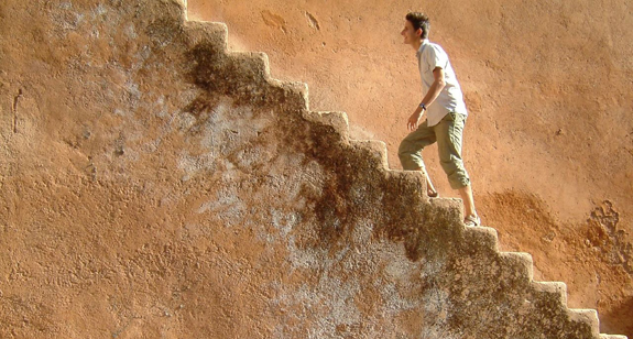 man climbing steps twa2r
