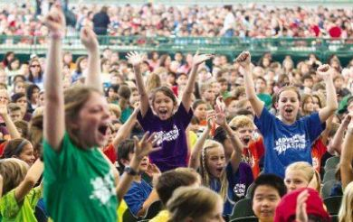 Buckalew Elementary School students cheer prior to a performance by the Houston Symphony during Fine Arts Education Day at Cynthia Woods Mitchell Pavilion Wednesday