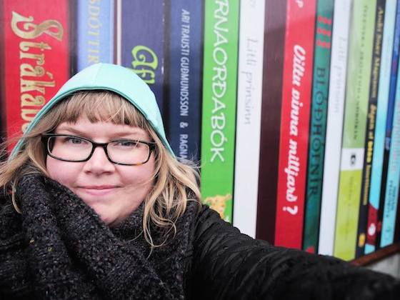 Stopping in front of Eymundsson book store's wall of gigantic volumes by Icelandic authors