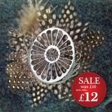 http://www.tweedvixen.co.uk/feather-brooch-with-laser-cut-motif-609-p.asp