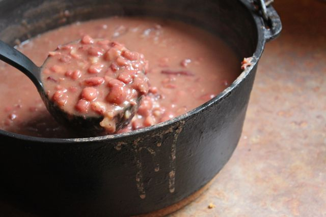 A black cast iron dutch oven full of red beans