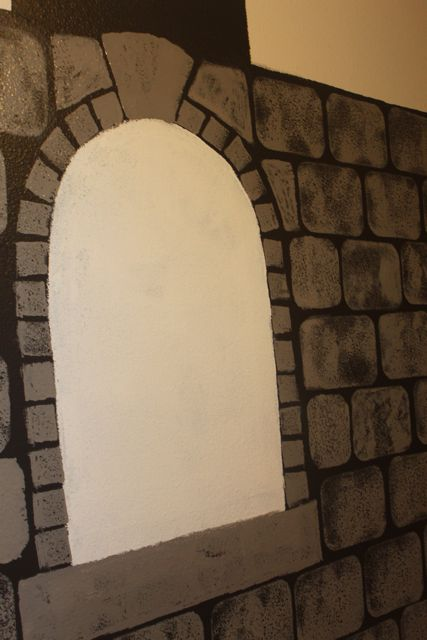 The beginning of the arched window on the faux castle wall