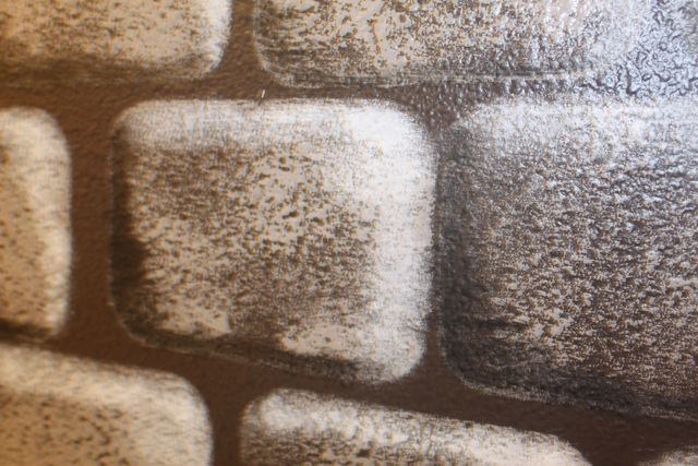 Close up of the highlighting on a faux brick