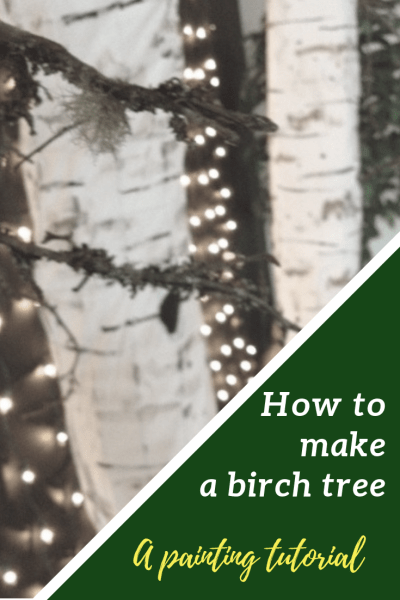 Picture of two fabric and chicken wire birch trees in front of miniature white lights