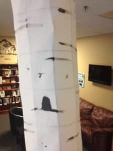 Painting initial random black spots and holes on birch tree