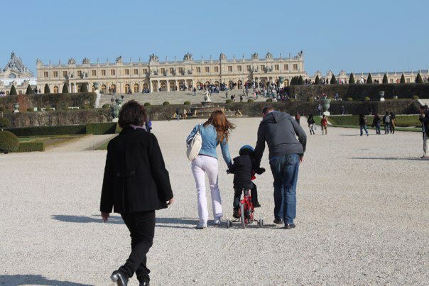 People walking toward the Palace of Versailles