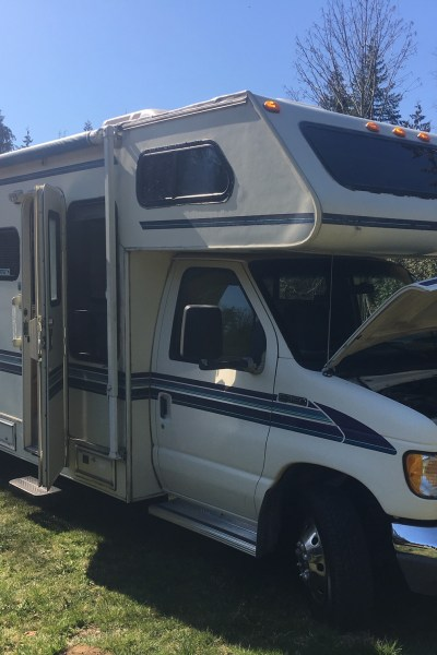 A 25 foot RV sitting on grass