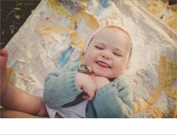 smiles and sweaters, one year old session, hair flowers