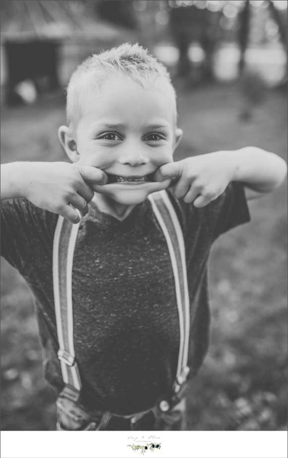 black and white children and family sessions, Des Moines Iowa, Sun Prairie to Des Moines, family sessions, children, outdoor sessions, rustic vintage sessions, grain belt, farm fields, farm equipment, grainery, siblings, happy families, silly children, funny faces, suspenders, dress up to get dirty, loving life, Dane county area children and family sessions, TOP