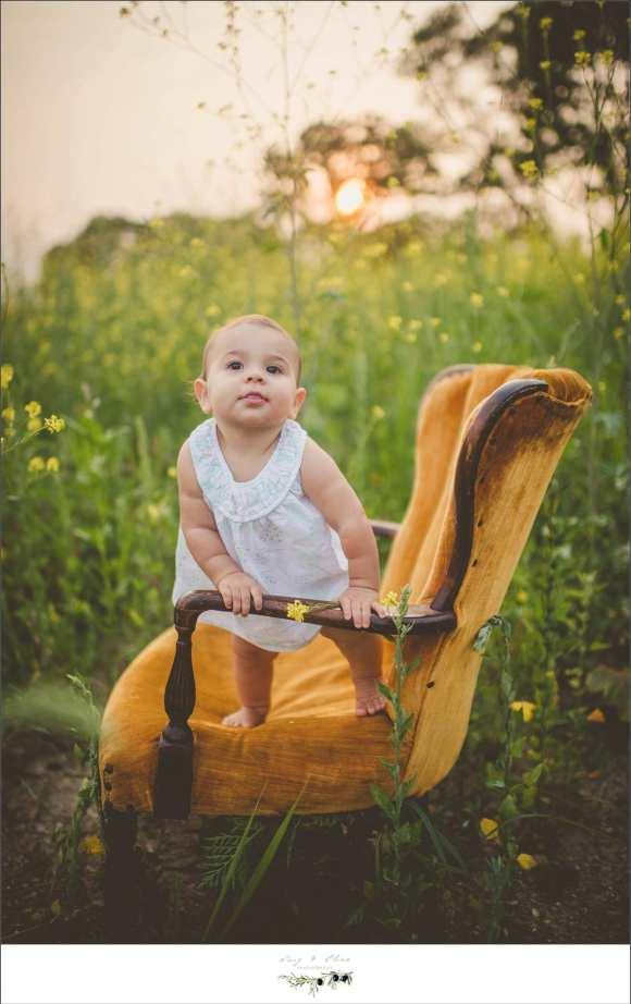 orange chair, white dress, hair flower, baby
