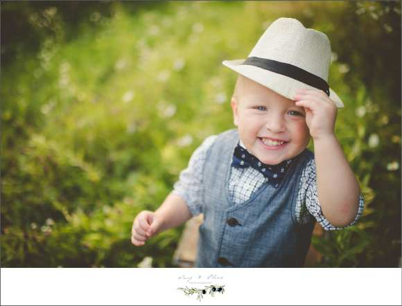 fedora, sharp dressed toddler, prairie grass, happy child