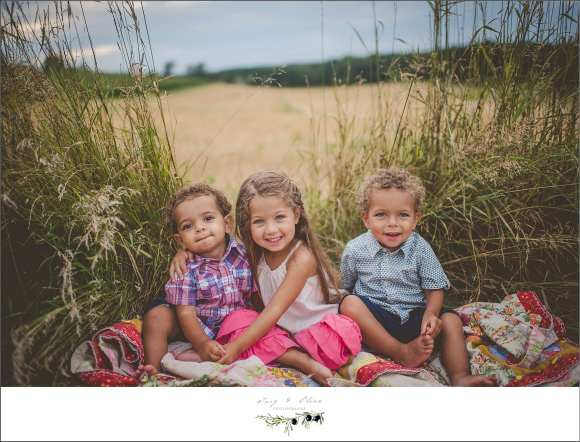 prairie grass, kids, blankets, three kids
