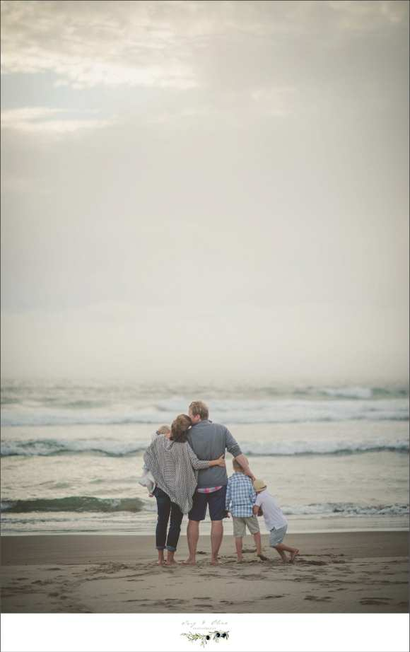 family embrace beachfront