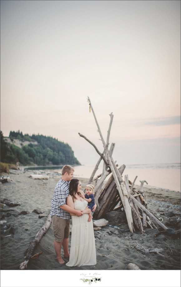 loving embrace in front of beach teepee
