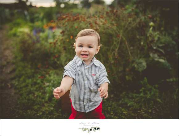 red pants and stripped shirt on happy toddler