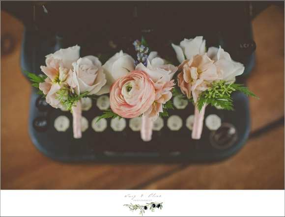 pink and peach wedding boutineers