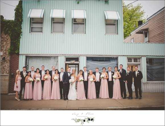 large wedding party posing
