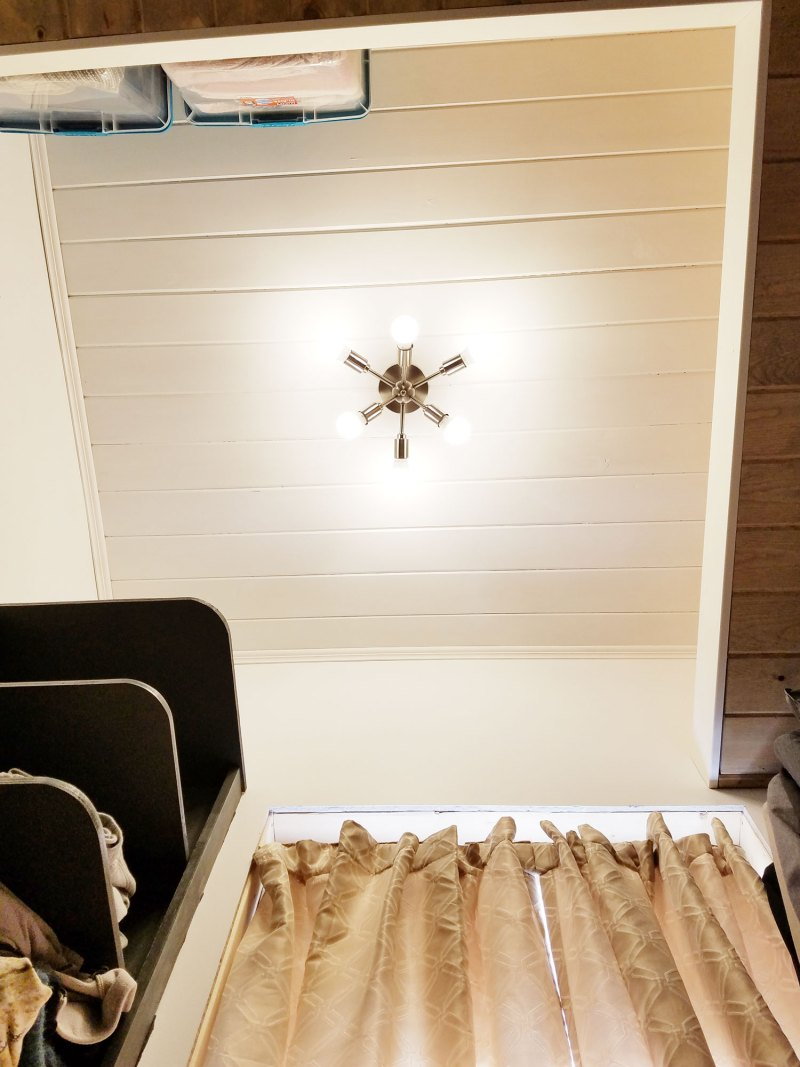shiplap ceiling and modern light fixture