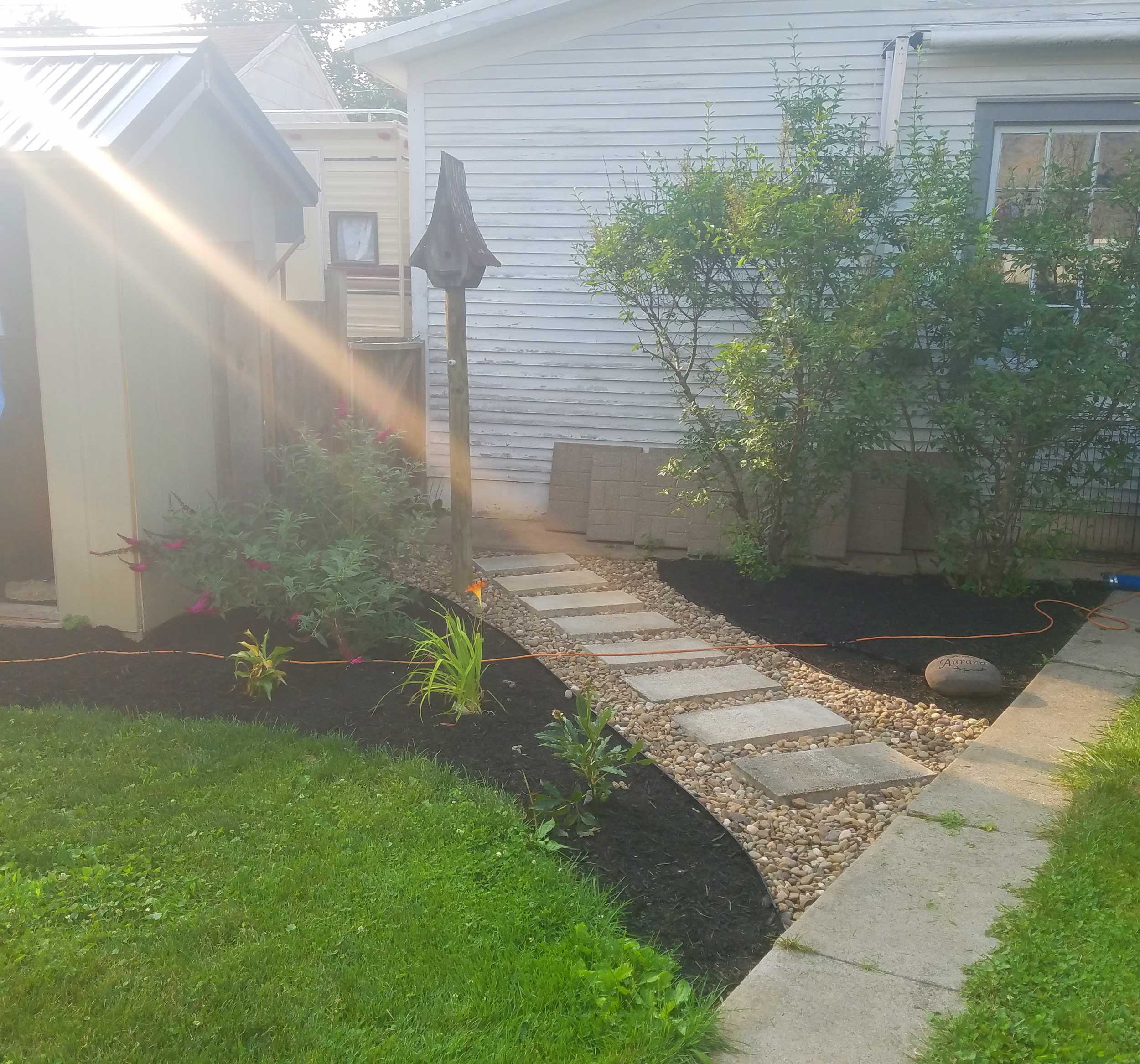 stone walkway in backyard