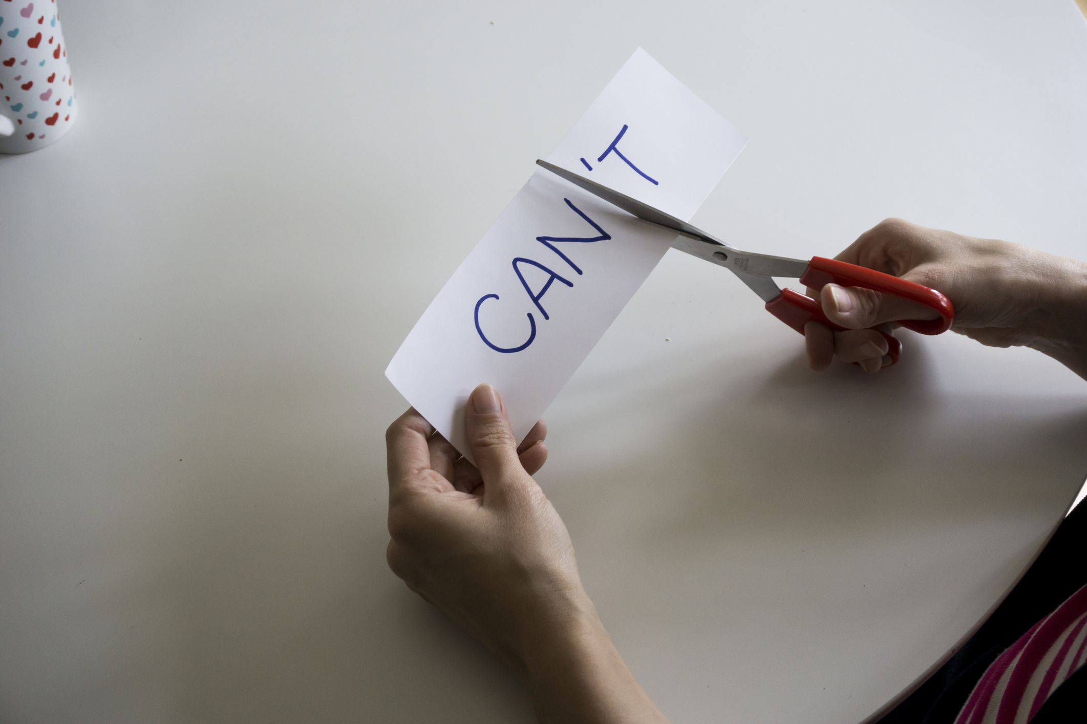 The word CAN'T, with the 'T cut off to spell CAN