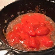 Add San Marzano whole tomatoes