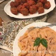 Meatballs cooked in sauce served with pasta
